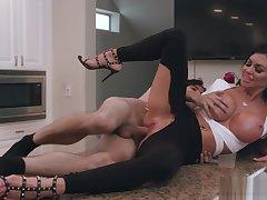 Buxom heeled cougar blows huge dick